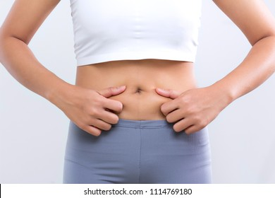 cellulite woman hand touch stomach healthy care