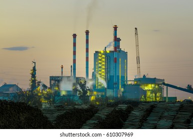 Cellulose factory plant by sunset