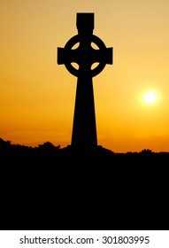 Celtic cross in silhouette on Tipperary Hill, a prodominatly Irish- American suburb of Syracuse, New York
