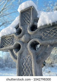 Celtic Cross statue in the snow