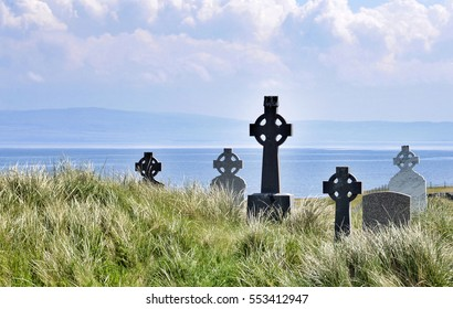 Celtic crosses standing in a graveyard on Inisheer off the west coast of Ireland
