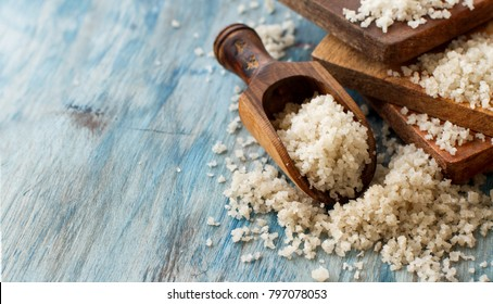 Celtic  Grey Sea Salt with a spoon on a blue wooden table