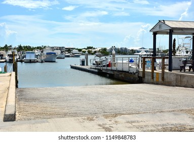 A cement back down boat launching ramp in a marina.