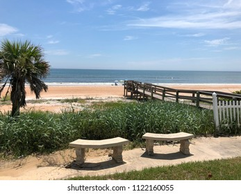 Cement benches at the beach.
