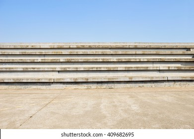 cement bleachers seats in an urban with blue sky background in sport centre