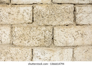Cement blocks are laid out with a wall, a texture