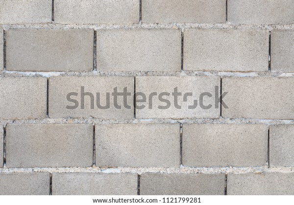 Cement blocks wall gray brick texture exterior fence background