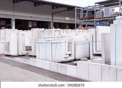 Cement building blocks stacked on pallets used for transportation and distribution at a hardware depot, warehouse or on a construction site