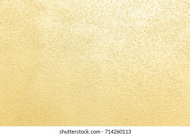 cement or concrete wall painted with yellow pearl color texture and background