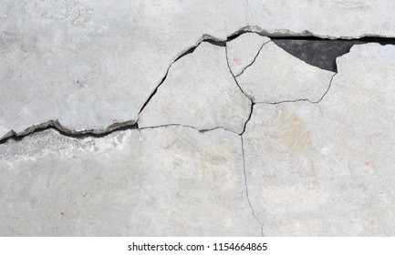 Cement crack wall texture background.
