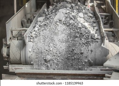 Cement factory. Conveyor with stones and gravel, tonnel. Modern technologies work at a cement plant. Technological work on the production of cement. Working atmosphere with copy space.