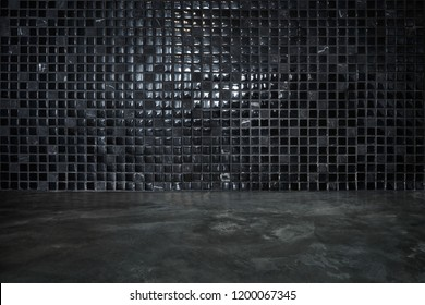 Cement floor with black stone and shiny mosaic wall background
