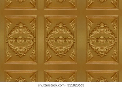 Cement gold Crafts wall in the temple close from thailand