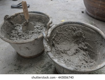 cement mix concrete is compacted sand, Construction worker laying bricks showing  and guideline,