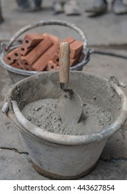 cement mix concrete is compacted sand, Construction site with cranes on sky background,