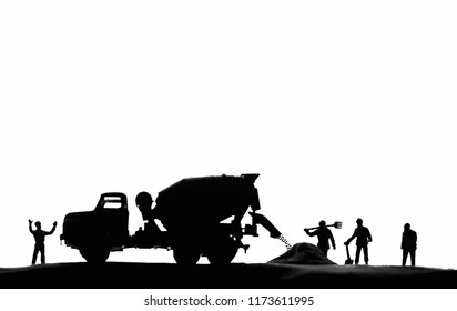 Cement mixer truck in building construction site.