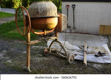 cement mixers and tools in the yard