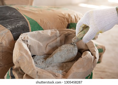 Cement or cement mortar with a trowel placed on a cement bag for construction work.