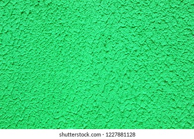 cement pattern on green wall