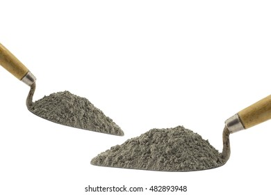 Cement pile or mortar pile with the trowel isolated on white background.