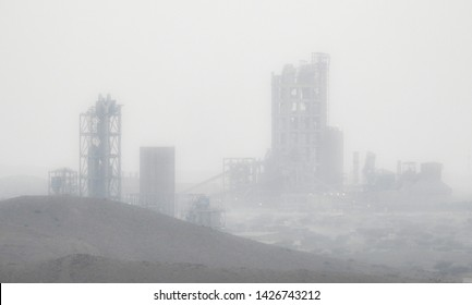 Cement plant in the desert in a sandstorm