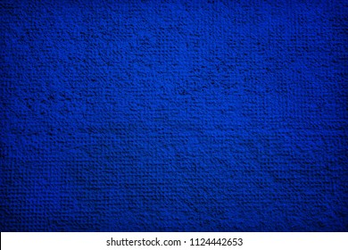 Cement or plaster wall. Blue background.