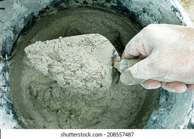 cement portland gray fresh mortar mix with spatula tool in bucket