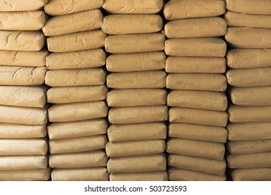 Cement powder bags stacked background
