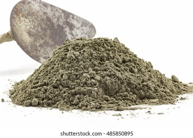 Cement powder or mortar pile with the trowel isolated on white background.