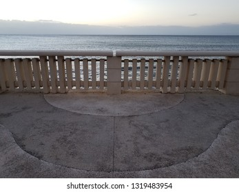 cement sidewalk and railing and water in Aguadilla, Puerto Rico