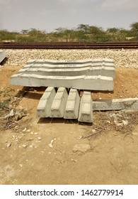 Cement Sleepers stacked  near a newly constructed railway line