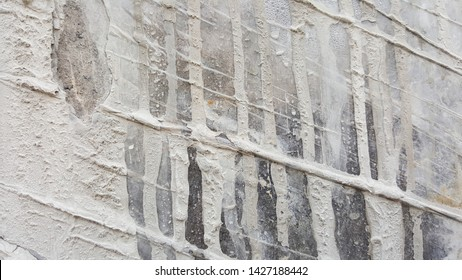 Cement slurry walls may be used as a background.