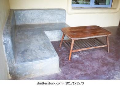Cement Sofa with Wooden table in coffee shop or resting area