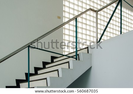 Cement Stair Railing Stainless Steel Up To The Second Floor With Glass  Block Wall.