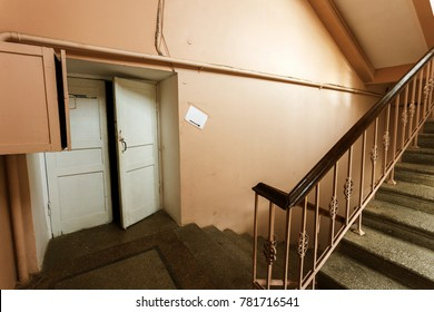Cement, stone stairs of the old building. A vintage stone staircase between the floors of an obsolete building. Building fashion and technology of the 20th century in the USSR