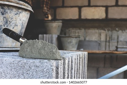 Cement and tools for industrial technicians in the construction of exterior walls