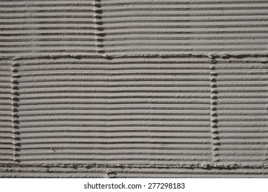 Cement wall in cocoa/light brown color.