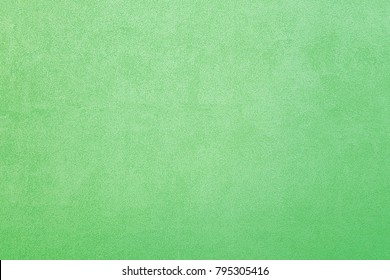 Cement wall texture in green color.