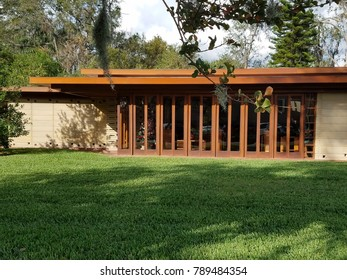 cement and wood house with many patio doors