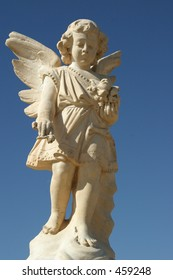 Cemetery Angel with a clear blue sky