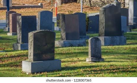 Cemetery in autumn sunshine, autumn leaves, no people, titanic graves, memorial.