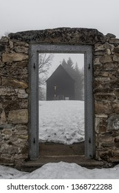 "Cemetery chapel st. ""Krize"" in extinct village Hurka. Sumava mountains, early spring, morning, haze, hiking trail."