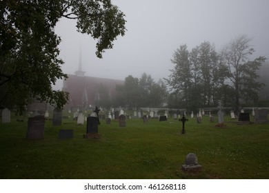 Cemetery and church in the fog