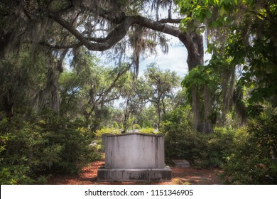 Cemetery grave headstone without writing in a classic, mysterious and hauntingly beautiful southern United States setting.