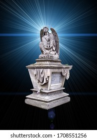 The cemetery monument in the form of an angel of white on a background of mystical light rays, blue color.