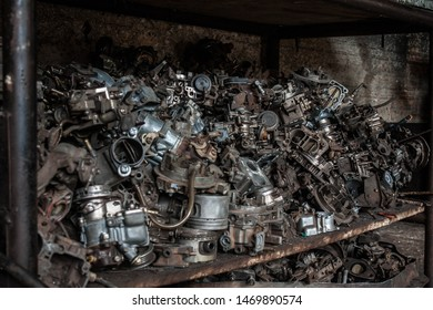 cemetery of old carburetors in mechanical workshop