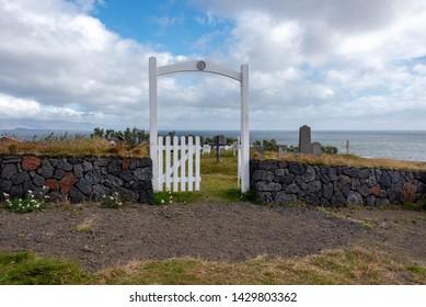 Cemetery on a grassy knoll near the sea