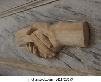 Cemetery. Ornament that represents a handshake, or the last goodbye to the deceased.