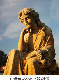 Cemetery statue in early morning light