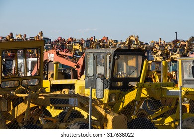 Cemetery storage scrapping old excavators and other construction machinery